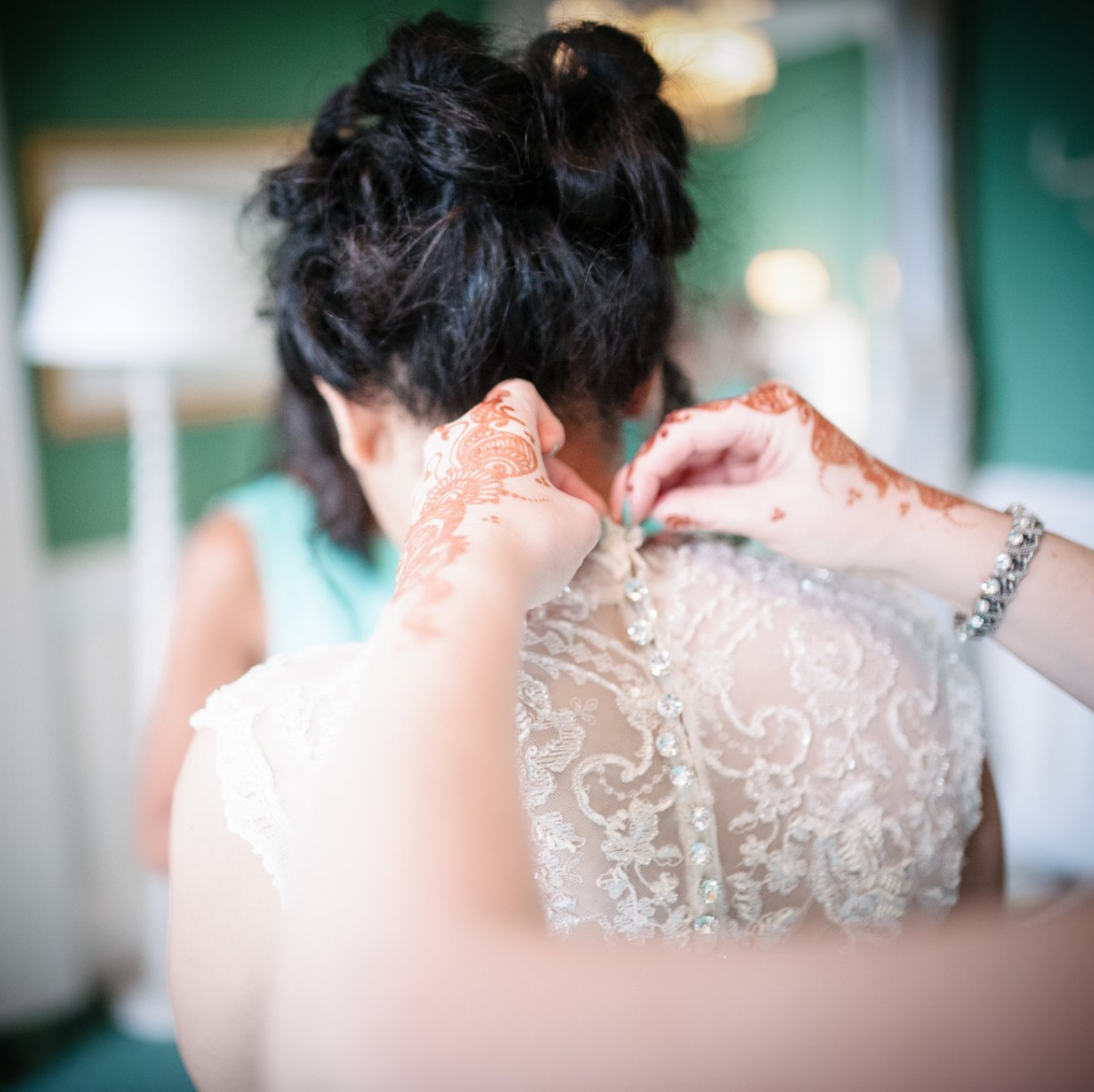 back of a wedding dress with crystal buttons