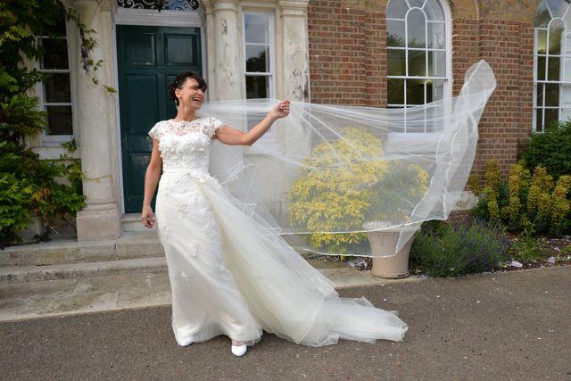 happy bride veil in wind